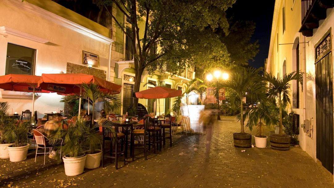 Cafe in small alley in the Zona Colonial at night, Santo Domingo.