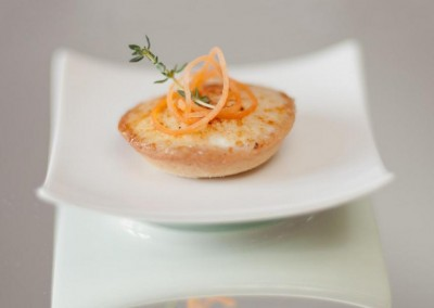 A appetizer with caramelized goat cheese from MI CORAZON Catering