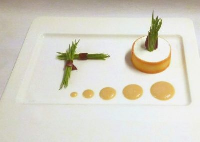 Goat cheese with peach vinaigrette and wheatgrass