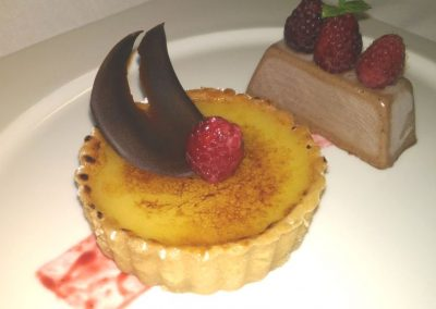 Caramalized lime tarte with chocolate semi frozen and raspberries